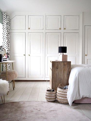 bedroom closet storage idea with multiple doors