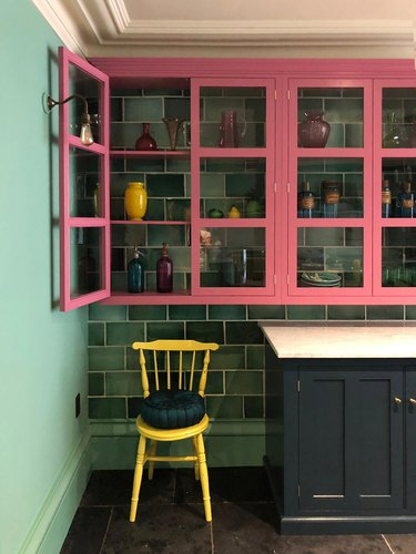 pink cabinets and green walls