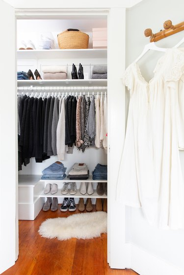master bedroom closet storage idea with shelving and hanging rod and shoe rack