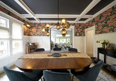 dining room space in a craftsman house with wallpaper above the trim