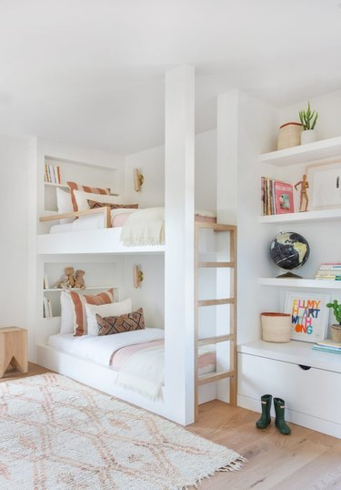 white bedroom with bunk beds accented with pastel hues