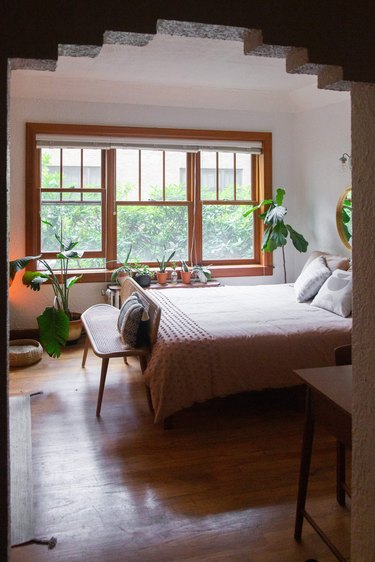 Bed next to large window
