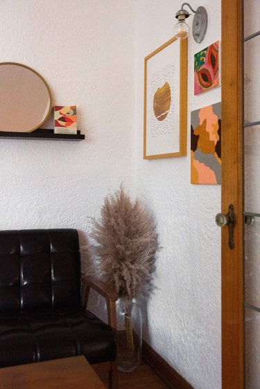 Artwork and a vase with pampas grass