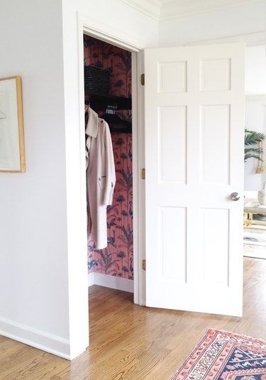 hallway closet storage idea with woven baskets on shelf and matching hangers
