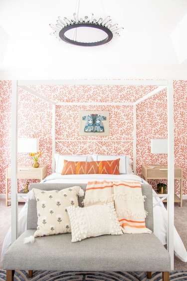 Chandelier above four-poster bed