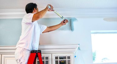 Painting an interior wall.