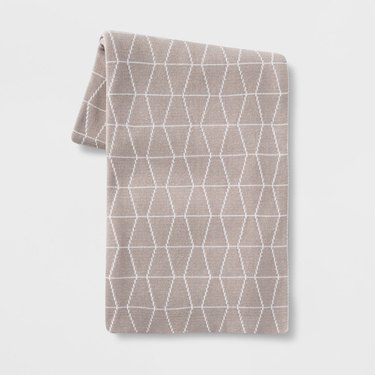 taupe and white throw blanket