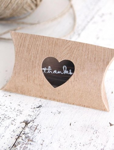 cardboard pillow envelope with heart-shape cut out