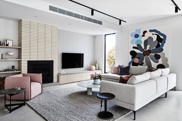 contemporary living room style with tile fireplace surround and sectional sofa