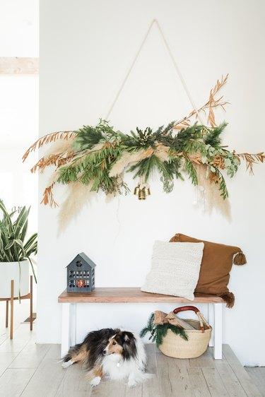 Holiday garland hanging on wall