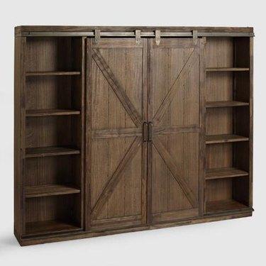 World Market farmhouse furniture with bard door book case