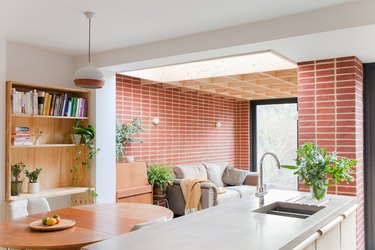 red brick wall in open concept floor plan