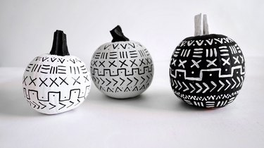 Black and white painted pumpkins