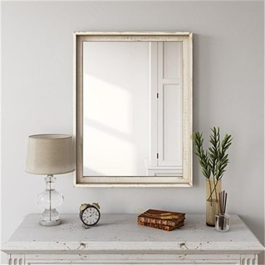 Walmart farmhouse decor with distressed wall mirror above chest of drawers