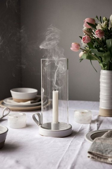 Anthropologie farmhouse decor on the table with ceramic dishware