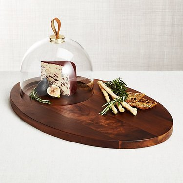Crate and Barrel farmhouse decor with wood cheese serving board