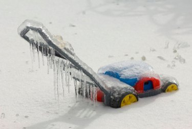 Lawnmower in the snow.