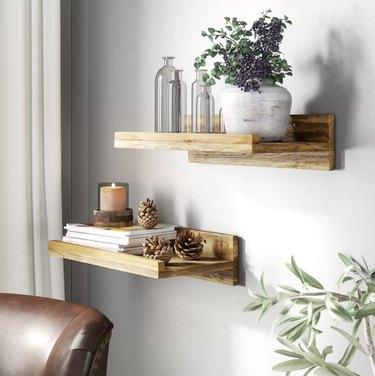 Wayfair farmhouse decor with wood floating shelves on the wall