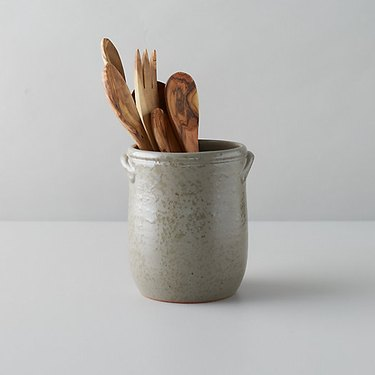Terrain farmhouse decor with ceramic cooking utensil holder and wooden serving spoons