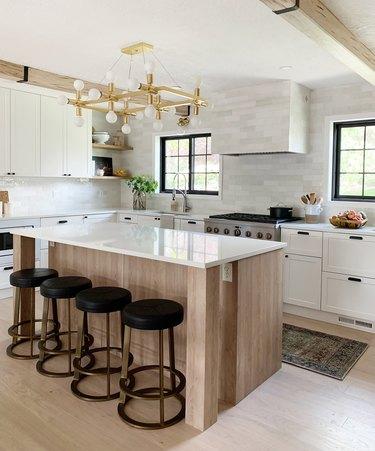 kitchen with modern chandelier installed above the kitchen island