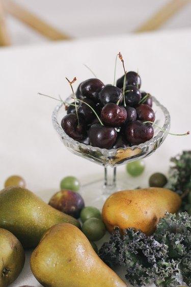 Bowl of long stem cherries