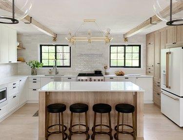 kitchen with white subway tile backsplash and oak hardwood floors