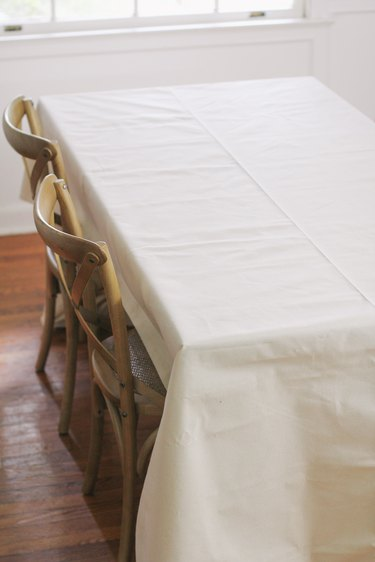 Canvas drop cloth draped over table