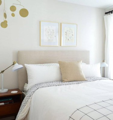neutral guest bedroom with white bedding