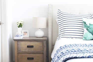 plain white table lamp on a nightstand