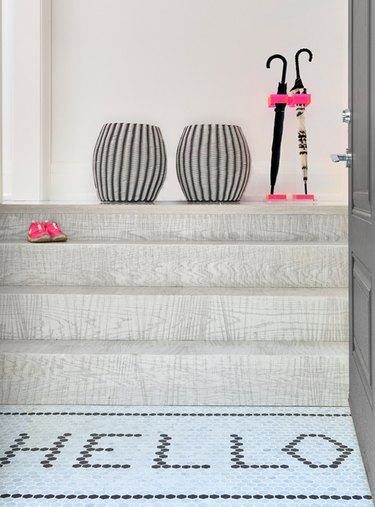 entryway landing with mosaic tile flooring
