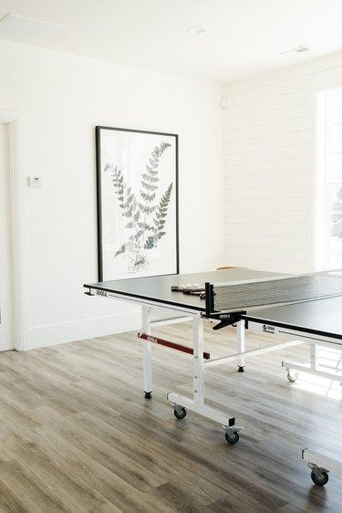 minimal garage game room ideas with botanical wall art