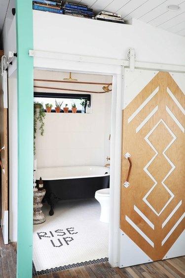 bathroom with mosaic word tile flooring