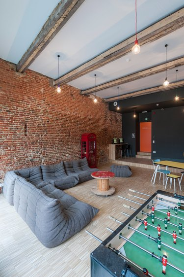 industrial garage game room ideas with sofa and table football
