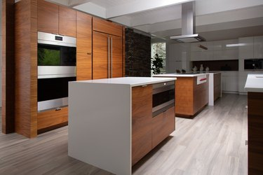 large kitchen with two islands and wood cabinets