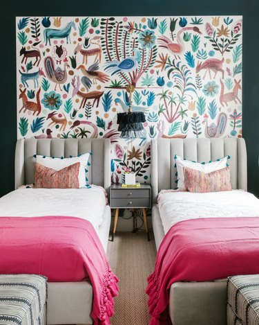 bohemian bedroom lighting idea with tasseled wall sconce hanging between two beds