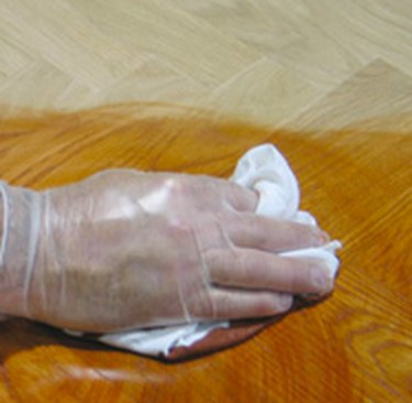 Applying stain with a rag.
