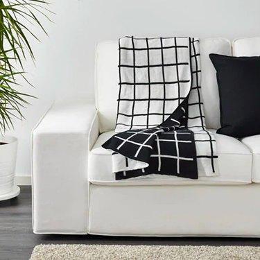 black and white throw blanket on white sofa