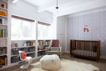 organized nursery with built-ins and bins