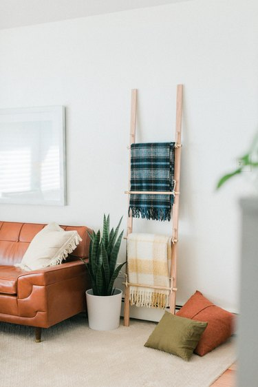 Layer blankets over the rungs for hanging storage.