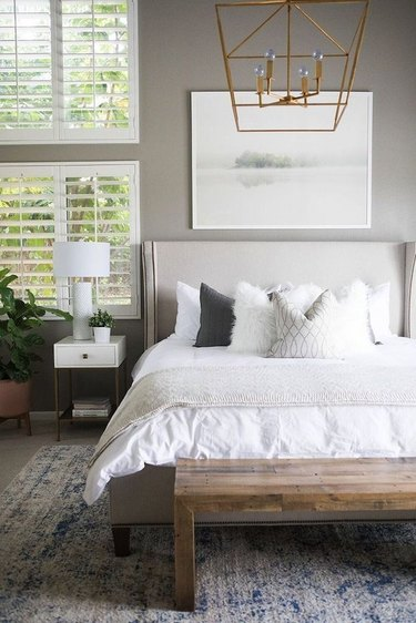 White shutter contemporary window treatments in a bedroom by Becki Owens