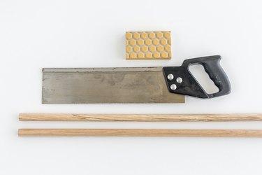 Cut the dowel rods in half.