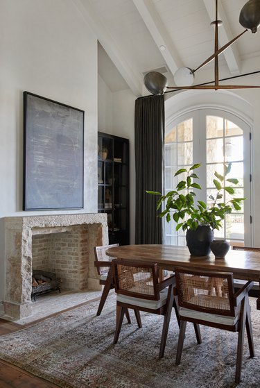Contemporary Window Treatments Tall slate gray drapes in a dining room designed by Amber Interiors