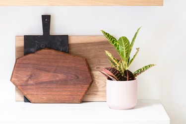 wood cutting boards an plant in IKEA pot