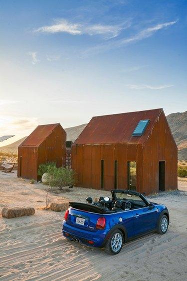 blue car near cabin