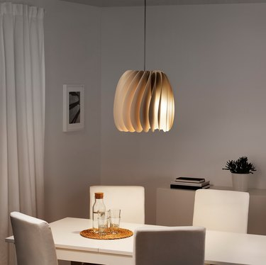 contemporary dining room lighting with plastic curved IKEA pendant