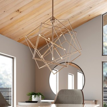 contemporary dining room lighting with geometric shape and gold finish