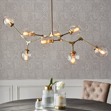 Brass and glass contemporary dining room lighting with branch chandelier over table