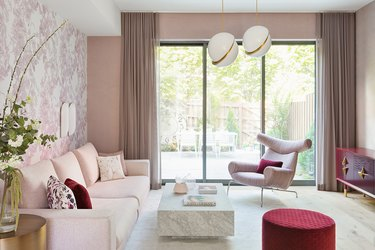 pink eskayel living room wallpaper idea with furniture in shades of pink