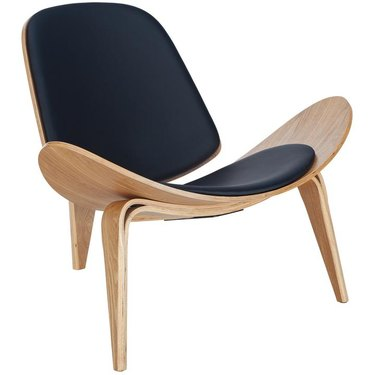 Molded plywood lounge chair, armless, with black back and seat