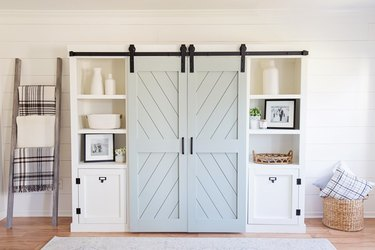 Barn doors hiding the middle of an entertainment stand